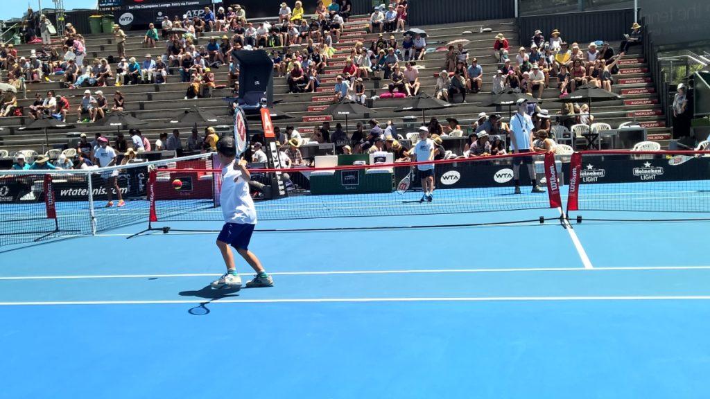 Kids playing tennis at ASB Classic.